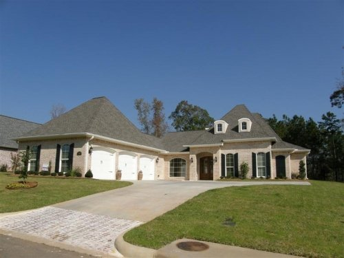 Custom Three Car Garage with Arched Top French Country Exterior
